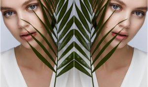 Fiatal nő növénnyel